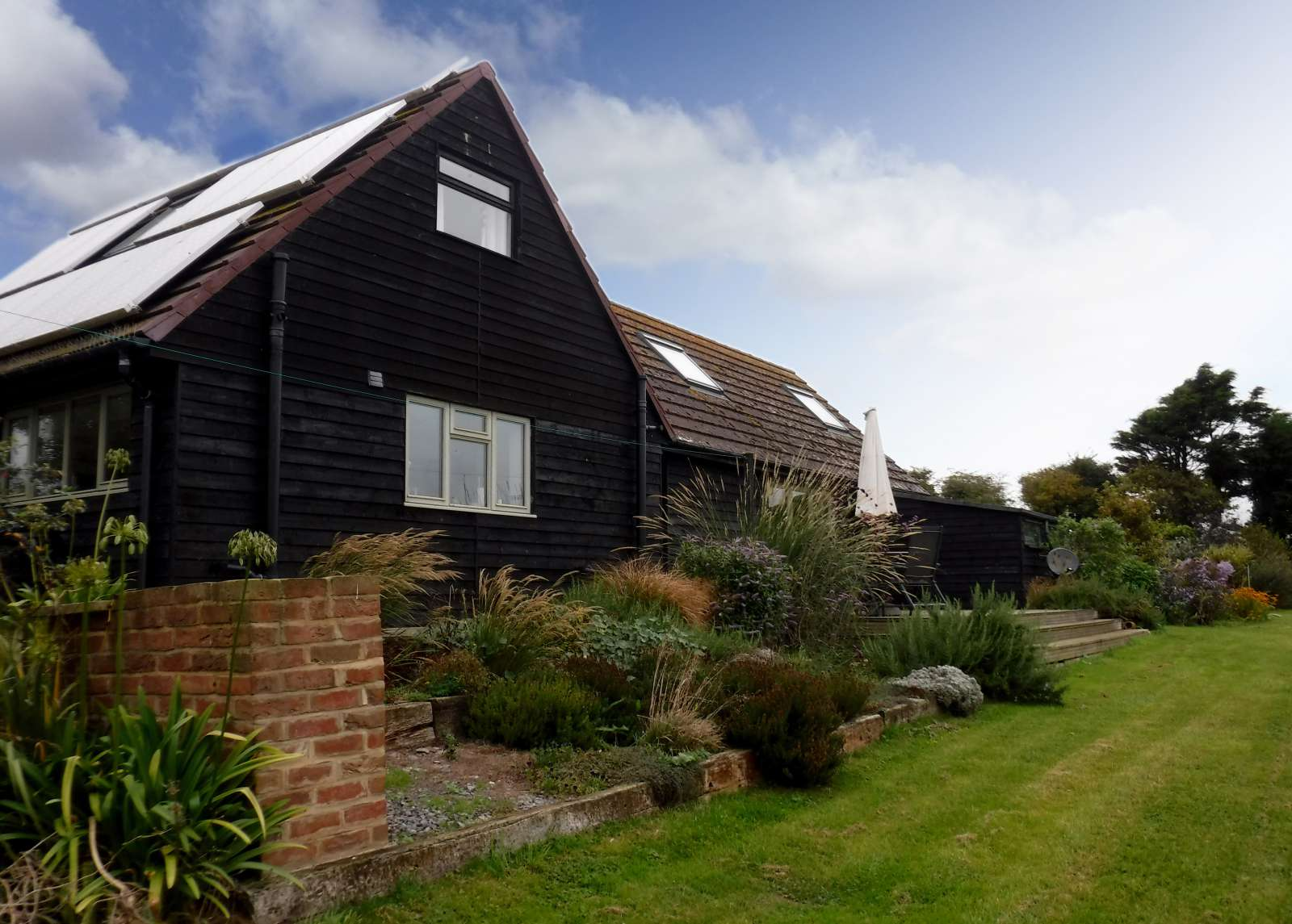 Holiday rental Cottage in Shorwell - The Little Barns East Facing Deck with BBQ, patio furniture and great views