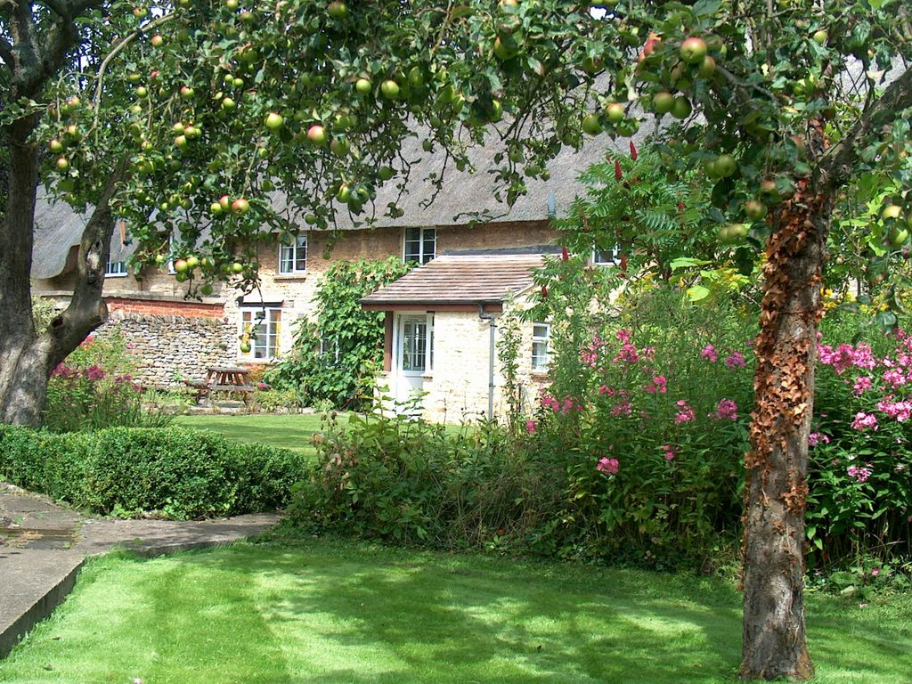 A Typical Thatched Cottage Built With Cotswold Stone Large Enclosed Garden